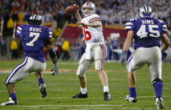 TEMPE, AZ - JANUARY 2:  Quarterback Craig Krenzel #16 of Ohio State looks for an open man against the defense of Kansas State during the first half of the Fiesta Bowl on January 2, 2004 at the Sun Devil Stadium in Tempe, Arizona.  (Photo by Jed Jacobsohn/