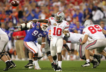 GLENDALE, AZ - JANUARY 08:  Quarterback Troy Smith #10 of the Ohio State Buckeyes attempts a pass against the Florida Gators during the 2007 Tostitos BCS National Championship Game at the University of Phoenix Stadium on January 8, 2007 in Glendale, Arizo