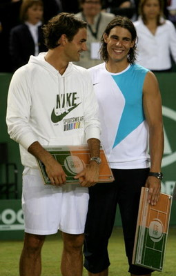 MALLORCA, SPAIN - MAY 2: Rafael Nadal of Spain and  Roger Federer of Switzerland share a joke after  the The Battle of the Surfaces between Rafael Nadal and Roger Federer at The Palma Arena on May 2, 2007 in Mallorca, Spain. (Photo by Clive Brunskill/Gett