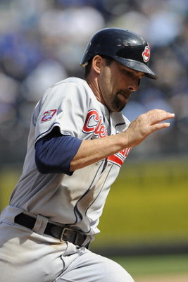 KANSAS CITY, MO - APRIL 15:  Mark Derosa of the Cleveland Indians, wearing a #42 jersey during the Jackie Robinson Day game runs past third base on the way to scoring a run against the Kansas City Royals on April 15, 2009 at Kauffman Stadium in Kansas Cit