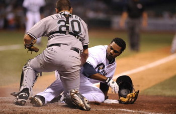 ST PETERSBURG, FL - JUNE 13:  Infielder Willy Aybar #16 of the Tampa Bay Rays topples catcher Matt Treanor #20 the Florida Marlins at Tropicana Field June 13, 2008 in St. Petersburg, Florida.  (Photo by Al Messerschmidt/Getty Images)