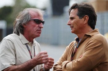 MELBOURNE, AUSTRALIA - MARCH 27:  Former drivers Jacques Laffite (L) and Nelson Piquet (R) talk in the paddock before practice for the Australian Formula One Grand Prix at the Albert Park Circuit on March 27, 2009 in Melbourne, Australia.  (Photo by Mark
