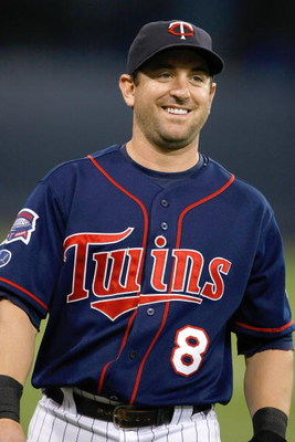 MINNEAPOLIS, MN - JULY 9:  Shortstop Nick Punto #8 of the Minnesota Twins smiles as he walks off the field against the New York Yankees at Hubert H. Humphrey Metrodome on July 9, 2008 in Minneapolis, Minnesota. The Yankees defeated the Twins 6-4. (Photo b