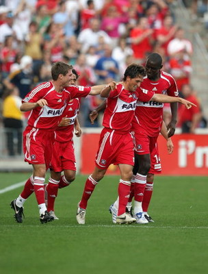 BRIDGEVIEW, IL - OCTOBER 21:  John Thorrington #11 of the Chicago Fire celebrates his late second-half goal with teammates against the Los Angeles Galaxy during their MLS match on October 21, 2007 at Toyota Park in Bridgeview, Illinois.  The Fire defeated