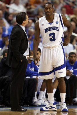 NORTH LITTLE ROCK, AR - MARCH 23:  Head coach John Calipari of the Memphis Tigers talks with his player Joey Dorsey #3 in the first half against the Mississippi State Bulldogs during the second round of the South Regional as part of the 2008 NCAA Men's Ba