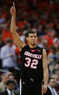 ST. LOUIS - APRIL 02:  Francisco Garcia #32 of the Louisville Cardinals gestures as he takes the court against the Illinois Fighting Illini during the NCAA Men's Final Four at the Edward Jones Dome on April 2, 2005 in St. Louis, Missouri.  (Photo by Ronal