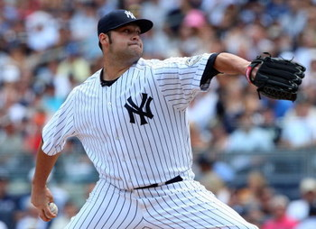 NEW YORK - JULY 19:  Joba Chamberlain #62 of the New York Yankees pitches against the Detroit Tigers on July 19, 2009 at Yankee Stadium in the Bronx borough of New York City.  (Photo by Jim McIsaac/Getty Images)