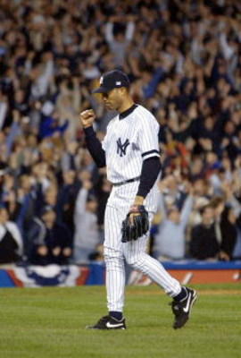22 Oct 2001:  Marino Rivera #42 of the New York Yankees celebrates after they won game Game 5 of the American League Championship Series between the Seattle Mariners and the New York Yankees at Yankee Stadium in the Bronx, New York. Yankees won the game 1