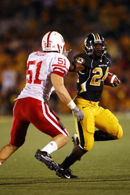 COLUMBIA, MO - OCTOBER 6:  Derrick Washington #24 of the Missouri Tigers stiff-arms Bo Ruud #51 of the Nebraska Cornhuskers during 2nd-half action on October 6, 2007 at Faurot Field in Columbia, Missouri.  Missouri won 41-6. (Photo by G. Newman Lowrance/G