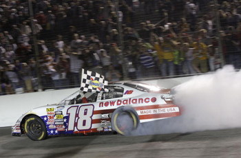 MADISON, IL - JULY 18:  Kyle Busch, driver of the #18 New Balance Toyota, performs a burnout after winning the NASCAR Nationwide Series Missouri-Illinois Dodge Dealers 250 at Gateway International Raceway on July 18, 2009 in Madison, Illinois.  (Photo by