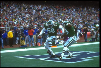 25 NOV 1990:  PHILADELPHIA EAGLES DEFENSEMAN BYRON EVANS #56 PERFORMS A DANCE IN THE ENDZONE AFTER RECOVERING A TURN OVER THAT RESULTED IN A TOUCHDOWN DURING THE EAGLES 31-13 WIN OVER THE NEW YORK GIANTS AT GIANTS STADIUM IN EAST RUTHERFORD, NEW JERSEY.