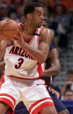 23 Mar 2001: Center Loren Woods #3 of the Arizona Wildcats looks for an open pass against the Ole Miss Rebels during the NCAA Tournament at the Alamodome in San Antonio, Texas. Arizona defeats Ole Miss 66-56.  DIGITAL IMAGE Mandatory Credit: Tom Hauck/ALL