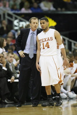 KANSAS CITY, MO - MARCH 14:  Head coach Rick Barnes speaks with D.J. Augustin #14 of the Texas Longhorns  against the Oklahoma State Cowboys during the Phillips 66 Big 12 Championship Quarterfinals at Sprint Center on March 14, 2008 in Kansas City, Missou