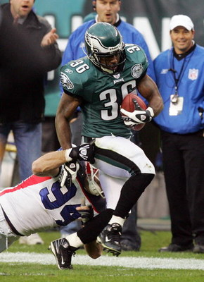 PHILADELPHIA - DECEMBER 30:  Brian Westbrook #36 of the Philadelphia Eagles runs a reception past Aaron Schobel #94 of the Buffalo Bills setting a team record with 89 catches on December 30, 2007 at Lincoln Financial Field in Philadelphia, Pennsylvania.