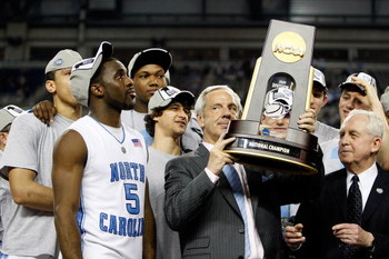 DETROIT - APRIL 06:  Head coach Roy Williams of the North Carolina Tar Heels celebrates with the championship trophy after defeating the Michigan State Spartans 89-72 during the 2009 NCAA Division I Men's Basketball National Championship game at Ford Fiel