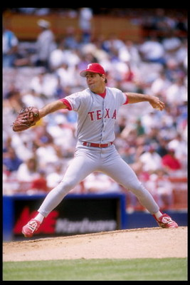 11 May 1995:  Pitcher Kenny Rogers of the Texas Rangers prepares to throw the ball during a game against the California Angels at Anaheim Stadium in Anaheim, California.  The Rangers won the game 6-2. Mandatory Credit: Stephen Dunn  /Allsport