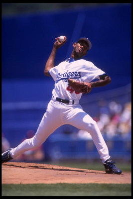 11 Jun 1995: Ramon Martinez of the Los Angeles Dodgers hurls a pitch in the direction of a Philadelphia Phillies at Dodger Stadium in Los Angeles, California.
