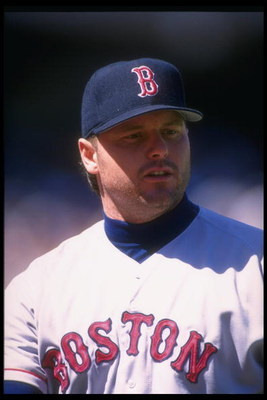 27 Aug 1995:  Pitcher Roger Clemens of the Boston Red Sox looks on during a game against the Oakland Athletics at the Oakland-Alameda County Coliseum in Oakland, California.  The Red Sox won the game, 4-1. Mandatory Credit: Otto Greule  /Allsport