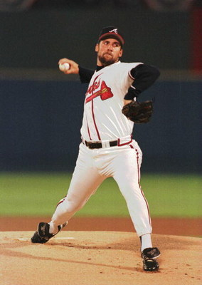 9 Oct 1996:  Pitcher John Smoltz of the Atlanta Braves winds up to throw a pitch during the Braves versus St. Louis Cardinals game 1 of the National League Championship Series at Fulton County Stadium in Atlanta, Georgia.  Mandatory Credit: Jonathan Danie