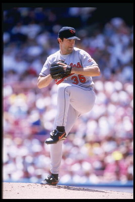 25 Jun 1997: Pitcher Mike Mussina of the Baltimore Orioles winds up to throw a pitch during the Orioles 9-1 win over the Milwaukee Brewers at Milwaukee County Stadium in Milwaukee, Wisconsin.