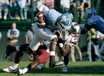 CHAPEL HILL, NC - OCTOBER 13:  Darian Stewart #32 of the South Carolina Gamecocks tackles Greg Little #8 of the North Carolina Tar Heels in the second quarter at Kenan Stadium October 13, 2007 in Chapel Hill, North Carolina.  (Photo by Grant Halverson/Get