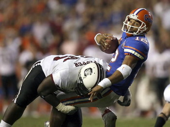 GAINESVILLE, FL - NOVEMBER 11:  Defensive tackle Nathan Pepper #95 of the South Carolina Gamecocks brings down quarterback Chris Leak #12 of the University of Florida Gators on a first down run to set up a touchdown in the fourth quarter on November 11, 2