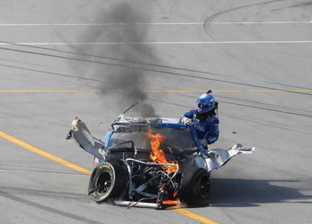 TALLADEGA, AL - APRIL 26:  Carl Edwards, climbs from the #99 Claritin Ford, after suffering damage at the conclusion of the NASCAR Sprint Cup Series Aaron's 499 at Talladega Superspeedway on April 26, 2009 in Talladega, Alabama.  (Photo by Christian Peter