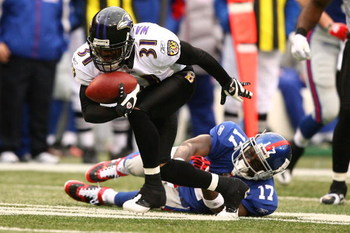 EAST RUTHERFORD, NJ - NOVEMBER 16:  Fabian Washington #31 of the Baltimore Ravens intercepts the ball as Plaxico Burress #17 of The New York Giants misses the tackle during their game on November 16, 2008 at Giants Stadium in East Rutherford, New Jersey.