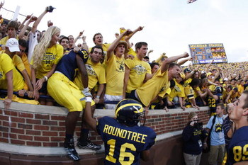 ANN ARBOR, MI - SEPTEMBER 27:  Michael Shaw #20 and Roy Roundtree #16 of the Michigan Wolverines celebrate with fans following the game against the Wisconsin Badgers on September 27, 2008 at Michigan Stadium in Ann Arbor, Michigan. (Photo by Gregory Shamu