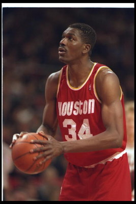 15 Jan 1994:  Center Hakeem Olajuwon of the Houston Rockets looks to shoot the ball during a game against the Chicago Bulls at the United Center in Chicago, Illinois. Mandatory Credit: ALLSPORT USA  /Allsport Mandatory Credit: ALLSPORT USA  /Allsport