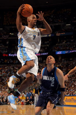 DENVER - MAY 13:  Chauncey Billups #7 of the Denver Nuggets dishes off a pass as Jason Kidd #2 of the Dallas Mavericks defends in Game Five of the Western Conference Semifinals during the 2009 NBA Playoffs at Pepsi Center on May 13, 2009 in Denver, Colora