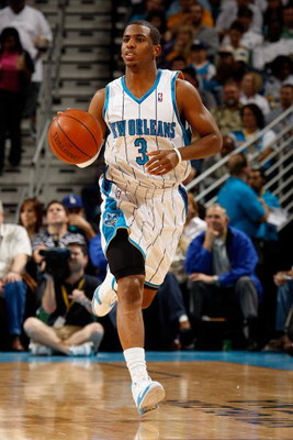 NEW ORLEANS - DECEMBER 26:  Chris Paul #3 of the New Orleans Hornets drives the ball up the court against the Houston Rockets on December 26, 2008 at the New Orleans Arena in New Orleans, Louisiana.  NOTE TO USER: User expressly acknowledges and agrees th