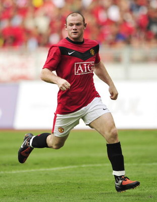 KUALA LUMPUR, MALAYSIA - JULY 18: Wayne Rooney of Manchester United runs for the ball during the pre-season friendly match between Manchester United and Malaysia XI at the Bukit Jalil National Stadium on July 18, 2009 in Kuala Lumpur, Malaysia. (Photo by