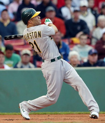 BOSTON - JULY 07:  Scott Hairston #21 of the Oakland Athletics hits a solo home run in the first inning off a pitch by Josh Beckett of the Boston Red Sox non July 7, 2009 at Fenway Park in Boston, Massachusetts.  (Photo by Elsa/Getty Images)