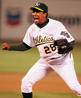 OAKLAND, CA - JULY 27:  Octavio Dotel #28 of the Oakland Athletics celebrates against the Seattle Mariners during a MLB game at the Network Associates Coliseum on July 27, 2004 in Oakland, California.  (Photo by Jed Jacobsohn/Getty Images)