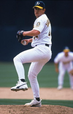 12 Apr 2000:  Jason Isringhausen #44 of the Oakland Athletics winds back to pitch the ball during the game against the Cleveland Indians at the Network Associates Coliseum in Oakland, California. The Indians defeated the Athletics 4-0. Mandatory Credit: J