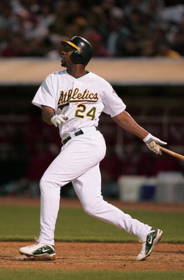 OAKLAND, CA - JUNE 29:  Outfielder Jermaine Dye #24 of the Oakland Athletics swings at an Anaheim Angels pitch during the game at the Associates Coliseum on June 29, 2004 in Oakland, California. The Athletics won 5-4.  (Photo by Jed Jacobsohn/Getty Images