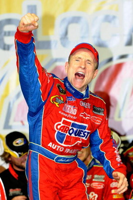 JOLIET, IL - JULY 11:  Mark Martin, driver of the #5 CARQUEST/Kellogg's Chevrolet, celebrates in victory lane after winning the NASCAR Sprint Cup Series LifeLock.com 400 at Chicagoland Speedway on July 11, 2009 in Joliet, Illinois.  (Photo by John Harrels