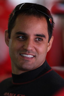 BROOKLYN, MI - JUNE 12: Juan Pablo Montoya, driver of the #42 Target Chevrolet, stands in the garage area during practice for the NASCAR Sprint Cup Series LifeLock 400 at Michigan International Speedway on June 12, 2009 in Brooklyn, Michigan.  (Photo by J