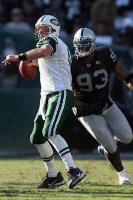 OAKLAND, CA - OCTOBER 19:  Brett Favre #4 of the New York Jets passes under pressure from Tommy Kelly #93 of the Oakland Raiders on October 19, 2008 at the Oakland-Alameda County Coliseum in Oakland, California. (Photo by Jed Jacobsohn/Getty Images)