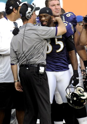 MIAMI, FL - JANUARY 4:  Coach John Harbaugh of the Baltimore Ravens hugs wide receiver Derrick Mason #85 after play against the Miami Dolphins during their AFC Wild Card Game at Dolphins Stadium on January 4, 2009 in Miami, Floirda.  (Photo by Al Messersc