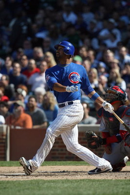 CHICAGO - APRIL 17:  Derrek Lee #25 of the Chicago Cubs bats against the St. Louis Cardinals on April 17, 2009 at Wrigley Field in Chicago, Illinois. (Photo by Jonathan Daniel/Getty Images)
