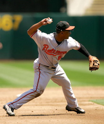 OAKLAND, CA - JUNE 07:  Melvin Mora #6 of the Baltimore Orioles throws to first base during their game against the Oakland Athletics at the Oakland Coliseum on June 7, 2009 in Oakland, California.  (Photo by Ezra Shaw/Getty Images)