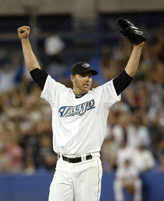 TORONTO - AUGUST 14:  Roy Halladay #32 of the Toronto Blue Jays celebrates his complete game win against the Los Angeles Angels of Anaheim on August 14, 2007 at the Rogers Centre in Toronto, Ontario, Canada.  (Photo by Dave Sandford/Getty Images)