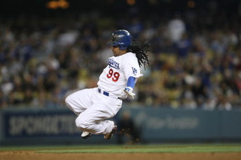 LOS ANGELES, CA - JULY 16:  Manny Ramirez #99 of the Los Angeles Dodgers slides into second base during the game against the Houston Astro's on July 16, 2009 at Dodger Stadium in Los Angeles, California.  (Photo by Stephen Dunn/Getty Images)