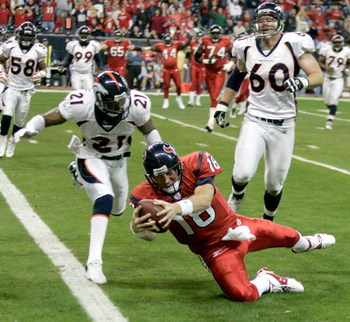 HOUSTON - DECEMBER 13:  Sage Rosenfels #18 of the Houston Texans dives for a touchdown during the the NFL game against Hamza Abdullah #21 and John Engelberger #60 of the Denver Broncos at Reliant Stadium on December 13, 2007 in Houston, Texas.   (Photo by