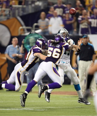 MINNEAPOLIS - SEPTEMBER 21:  Right end Jared Allen #69 and linebacker E.J. Henderson of the Minnesota Vikings rush quarterback Jake Delhomme #17 of the Carolina Panthers at the HH Humphrey Metrodome on September 21, 2008 in Minneapolis, Minnesota.  The Vi