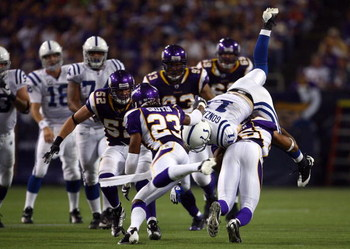 MINNEAPOLIS - SEPTEMBER 14:  Wide receiver Anthony Gonzalez (R) #11 of the Indianapolis Colts is tackled by Tyrell Johnson #25 of the Minnesota Vikings in the fourth quarter at the Metrodome on September 14, 2008 in Minneapolis, Minnesota. The Colts defea
