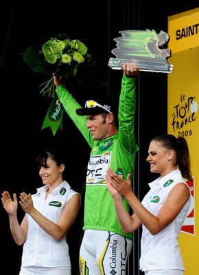 SAINT-FARGEAU-PONTHIERRY, FRANCE - JULY 15:  Stage winner Mark Cavendish of Great Britain and Team Columbia HTC celebrates in the green jersey on the podium after winning stage 11 of the 2009 Tour de France from Vatan to Saint-Fargeau-Ponthierry on July 1