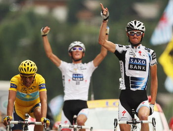 LE GRAND BORNAND, FRANCE - JULY 22:  Frank Schleck of Luxembourg and Saxo Bank crosses the finish line in front of Alberto Contador and Andy Schleck to win stage 17 of the 2009 Tour de France from Bourg-Saint-Maurice to Le Grand Bornand on July 22, 2009 i
